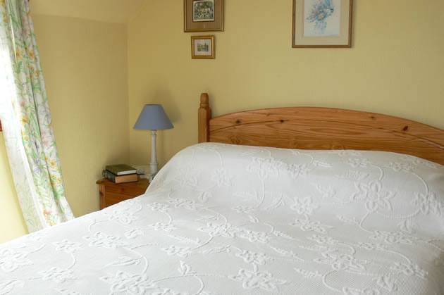 Comfortable double bed in our yellow room